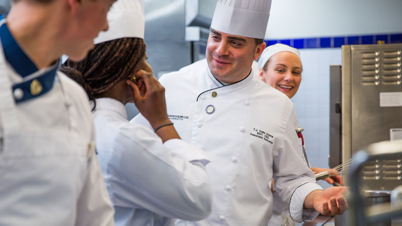 Culinary students with chef instructor