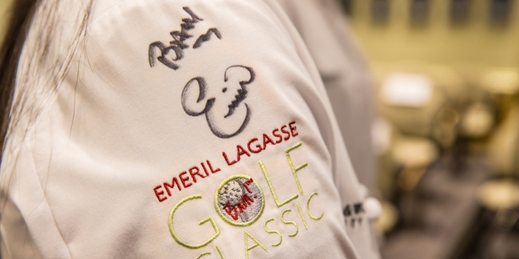 Chef coat autographed by Emeril